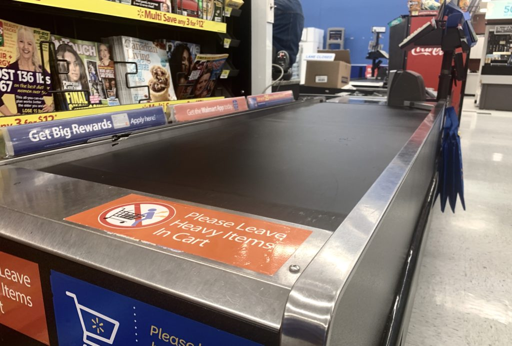 In this image: A grocery store conveyor belt.