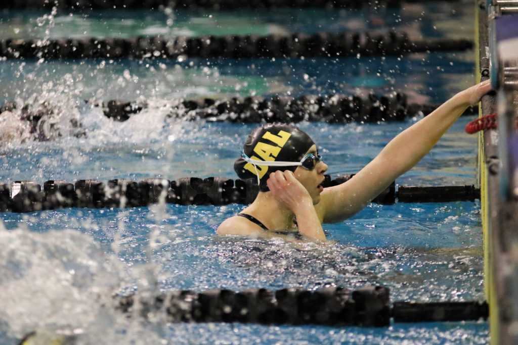 In this image: Isabel Sarty just completing the 100m freestyle.