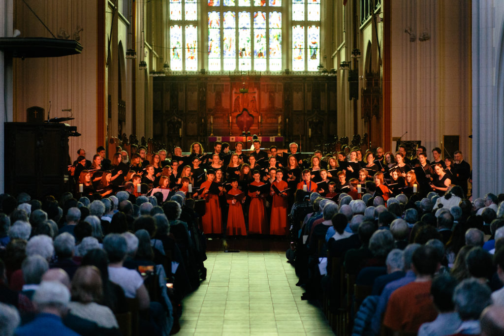 In this image: The King's Chorus performing at St. Mary's Basilica.