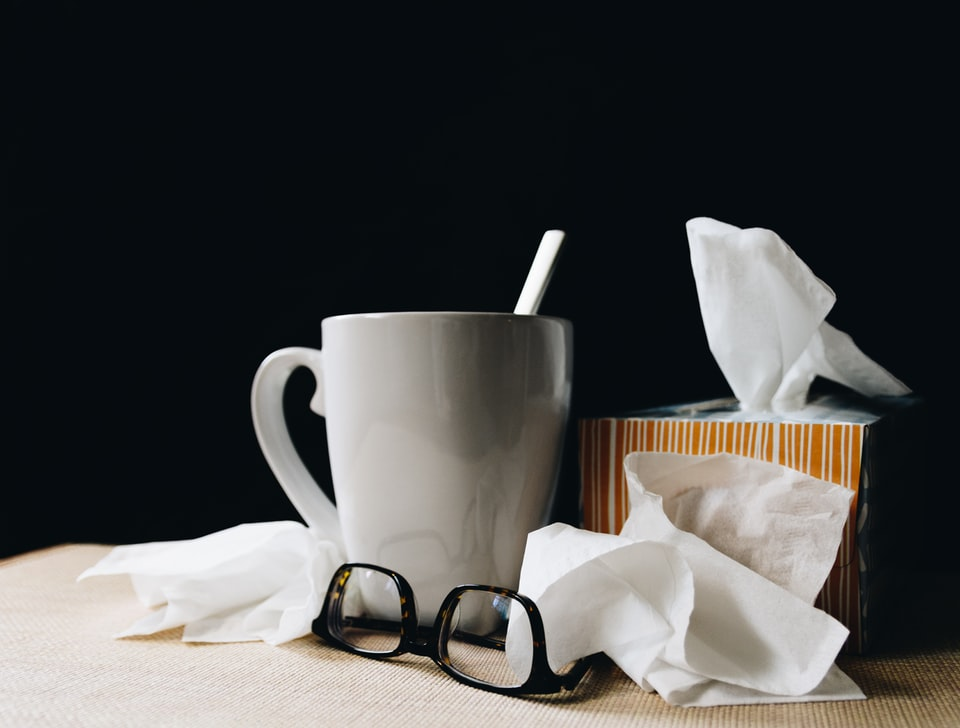 In this image: Tissue, glasses and a white mug.