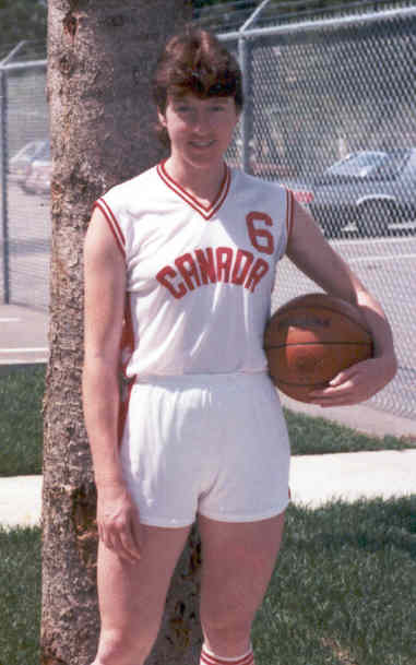 In this image: Anna Stammberger in 1983 holding a basketball and wearing a Team Canada jersey.