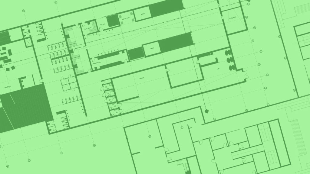 In this image: Green blueprints of a building.