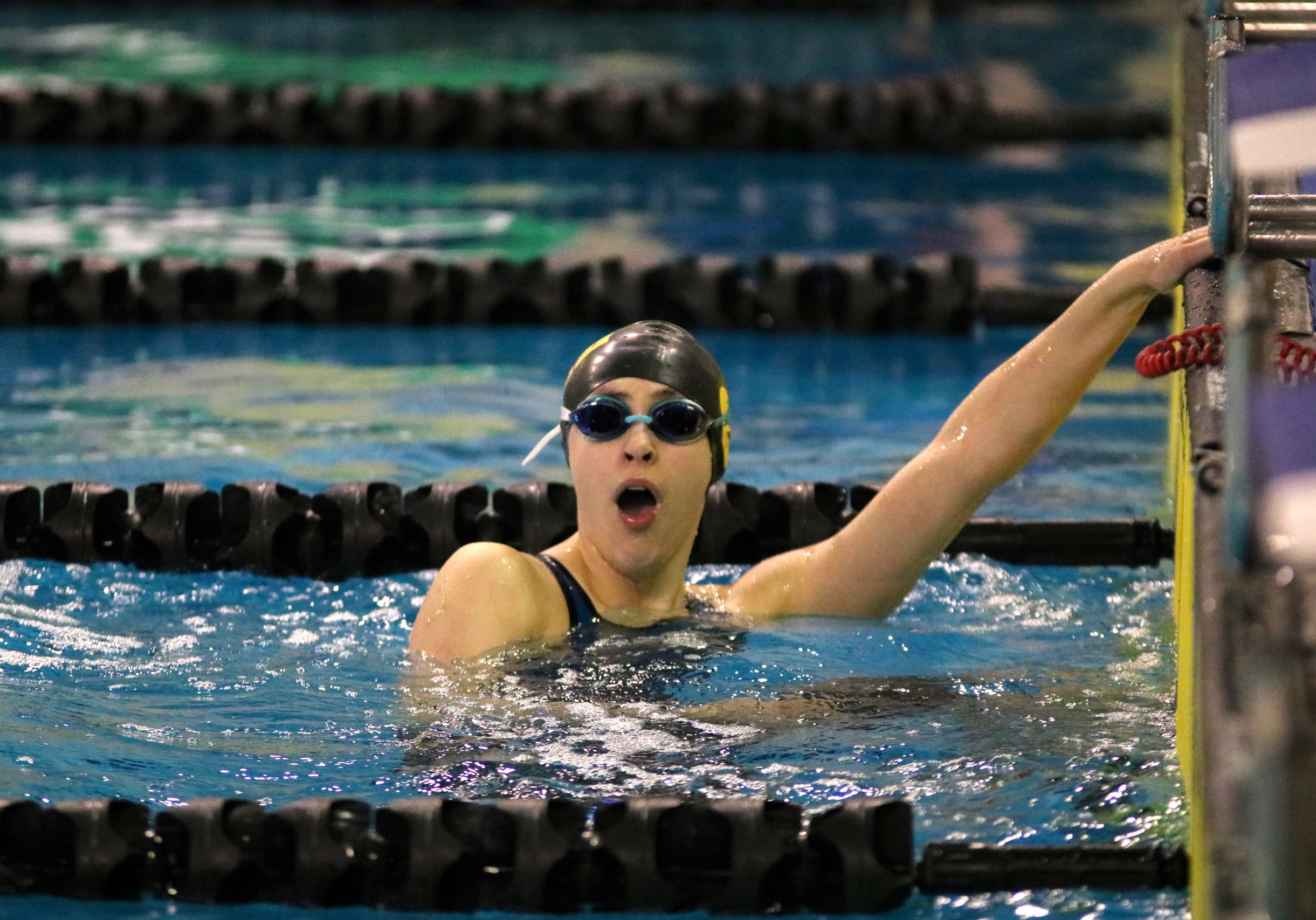 In this image: Isabel Sarty right after winning the 100m freestyle.