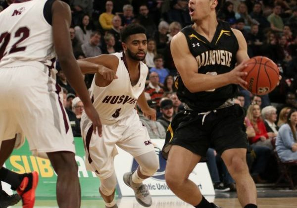 Jordan Brathwaite looks to pass the ball to Mike Shoveller as he is guarded by Andre Ntivumbura and Nevell Provo.