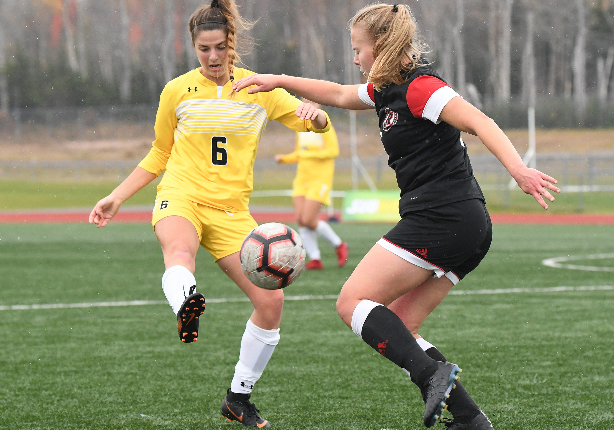 In this image: Two players during the Dalhousie versus University of New Brunswick game on Oct. 31.