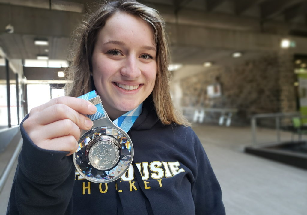 In this image: Natalie Stanwood holds a silver medal.